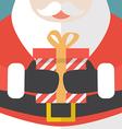 Santa Claus holding a Christmas gift vector image vector image