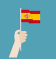 hand holding up spain flag vector image
