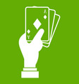 hand holding playing cards icon green vector image vector image