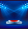 stage with red carpet and spotlight on blue vector image vector image