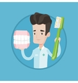 Dentist with dental jaw model and toothbrush vector image vector image