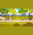 couple riding bicycles in public park over city vector image vector image