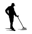 silhouette man searches for treasures with a metal vector image vector image