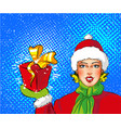 Pop art girl in santa costume holding gift