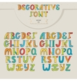 Big set of colorful decorative letters on beige vector image vector image