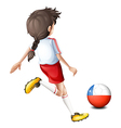 A female player kicking the ball with the flag of
