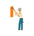 painter painting wall with roller male vector image vector image