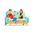 young couple in love sitting on a light blue sofa vector image vector image