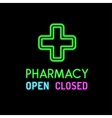 Pharmacy neon sign on black background vector image vector image
