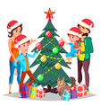 parents with children decorating a christmas tree vector image vector image