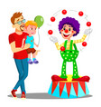 father and son in amusement park clown vector image