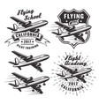 flying school emblems with airplane vector image vector image