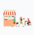 women are buying fast food from a shop vector image