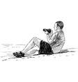 photographer at seaside vector image vector image