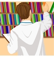 young male doctor taking book from shelf vector image vector image