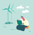 woman with laptop sitting on ground near windmills vector image