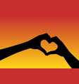 hands in shape of heart at sunset vector image