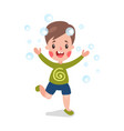 cute cartoon smiling little boy having fun playing vector image
