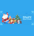 santa claus with elfs over christmas tree on happy vector image