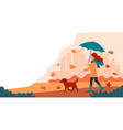 woman walking a dog in autumn with umbrella cute vector image vector image