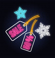 Winter sale neon sign with christmas tag hanging