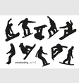 Black silhouettes of snowboarders on a white