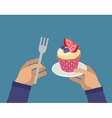 Hands with cupcake and fork vector image vector image