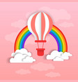 colorful air balloon over pink sky clouds vector image