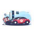 red electric car charging at the charger station vector image vector image