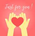 Two hands holding the heart vector image vector image