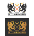 two gryphons wita a swords hold a shield vector image vector image