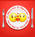 two kissing emoji faces in love emoticon concept vector image