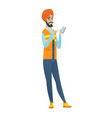 young hindu builder holding a mobile phone vector image vector image
