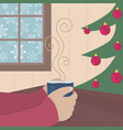 drinking coffee next to xmas tree by snowy window vector image