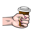 hand holding a coffee paper cup vector image