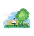 young guy reading a book in a park near bike vector image