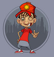 cartoon guy in a red cap winks and shows a gesture vector image vector image