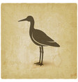 silhouette standing stork on vintage background vector image vector image