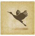 silhouette taking flight stork on vintage vector image vector image