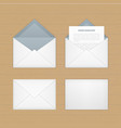 opened paper envelop with letter on wood vector image vector image