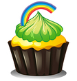 A cupcake with a green icing vector image