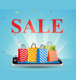 sale with smartphone and colorful shopping bags vector image vector image