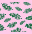 seamless pattern green palm leaves on pink vector image vector image