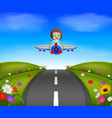young boy riding a plane on a beautiful scene vector image vector image