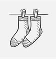 socks on the clothesline hand drawn sketch icon vector image