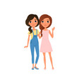 couple of young women standing together and vector image vector image