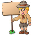 scout boy holding wooden board vector image