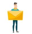 Smiling businessman holding a big envelope vector image vector image