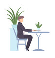 man in a black suit sits at a table vector image vector image