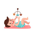cute little boy lying on his back playing with toy vector image